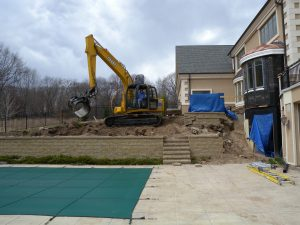 before retaining wall pool home