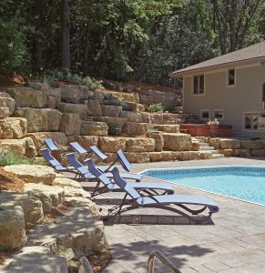 boulder retaining wall with pool